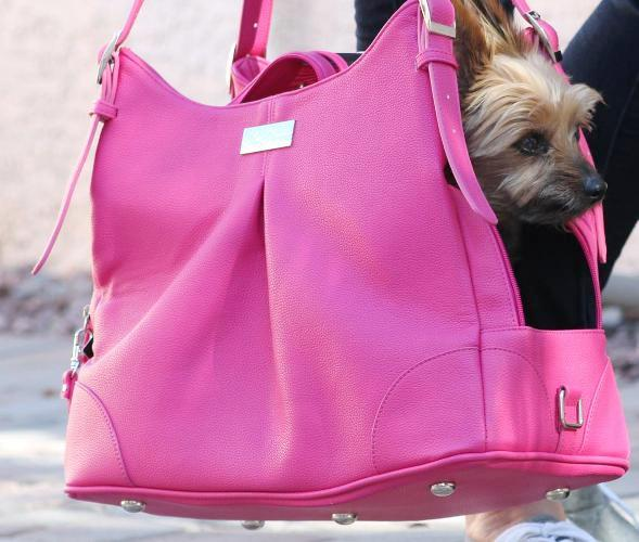 Doggie Design - Pink Yarrow Carry Bag - Airline Approved. Doggie Design's new Pink Yarrow Carry Bag was made to look like a Woman's Designer Hand Bag. Now you can take your little Angel with you wherever you go and NO ONE will ever know what's inside your bag. It features High Quality Faux Leather and is lined with Satin Black Waterproof Fabric. Your little Angel will LOVE the super soft plush pillow with removable and washable cover. The inside pillow is covered with waterproof fabric. The Pink Yarrow Bag features 2 large pockets for storage. It has plenty of room for your personal items, including your I-Pad or Tablet. Pink Yarrow is vented on the top and can be concealed for Privacy.  Includes shoulder strap, leash tether, and has metal feet on the bottom to provide protection to the bag.