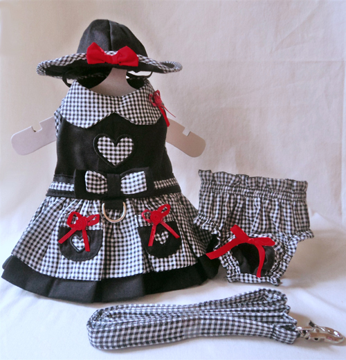 Platinum Puppy Couture - My Heart 4-pc Harness Dress Set - This smart and stylish harness dress is black, with contrasting black and white gingham print collar, over-skirt, and trim.  The bodice and pockets have heart-shaped cut-outs to show off the gingham print.  Red bow accents add a splash of color.