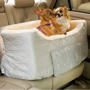The Snoozer Large Lookout II dog car seat provides your pets the perfect place to ride together while on the move. Provide your pets the perfect place to ride together while on the move. Perfect for owners who own multiple pets, the Snoozer large lookout car seat is made with a simulated lamb's wool interior to provide yours pets with a cozy place to travel. For added convenience, there is a storage drawer compartment for all of your pets needs.